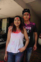 Govinda celeting Holi with His family wife daughter 002.JPG