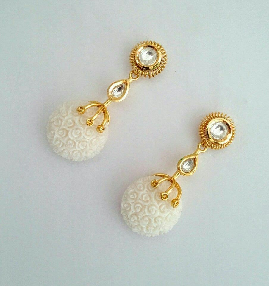 Fancy golden earring designs
