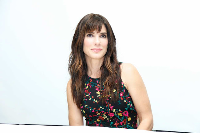 Sandra Bullock is chic in a floral dress at the 'Our Band is Crisis' press conference