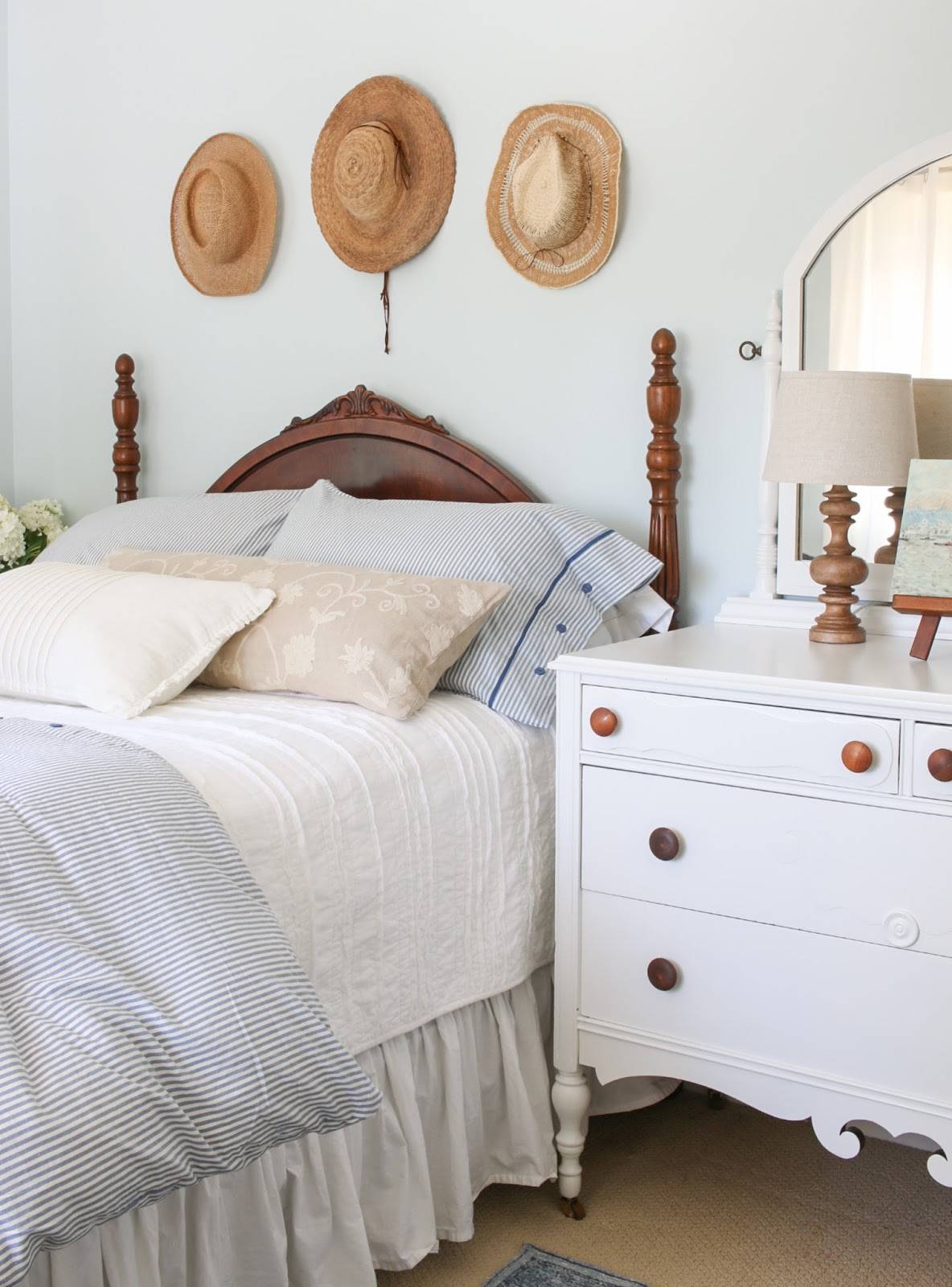 white painted dresser and white bedding