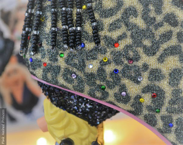 close up of multi coloured embellished jewels on side back of ankle boot