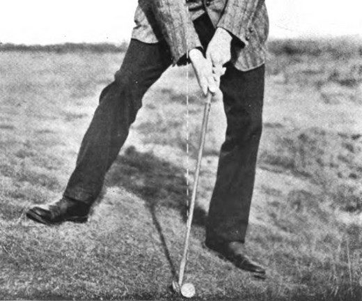 golfer setting up for a hanging lie