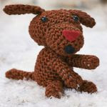http://www.letsknit.co.uk/free-knitting-patterns/floyd-the-singing-dog
