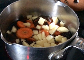 saucepan with ingredience for homemade sugar substitute for baking: carrot, apricot and apple