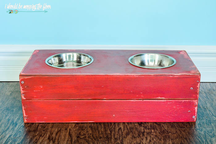 DIY Raised Dog Feeder | This fun dog feeding station was made from a crate and painted to fit in with the owner's decor! Check out how easy it is to put together.