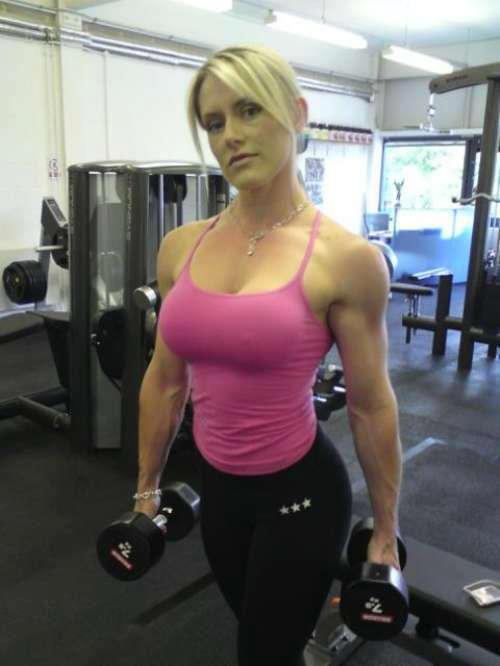 Fit Women Strong Woman In The Gym Fit young woman lifting barbells looking focused, working out in a gym. fit women blogger
