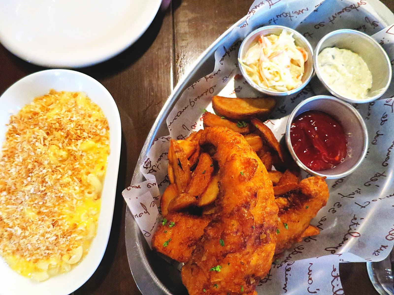 Photo of Fish and Chips next to a dish of Mac'n'cheese from Burger B