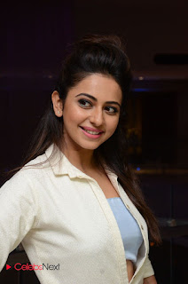 Rakul Preet Singh looks really cute in a White Gown with open Buttons at Sarrainodu Sucess Meet