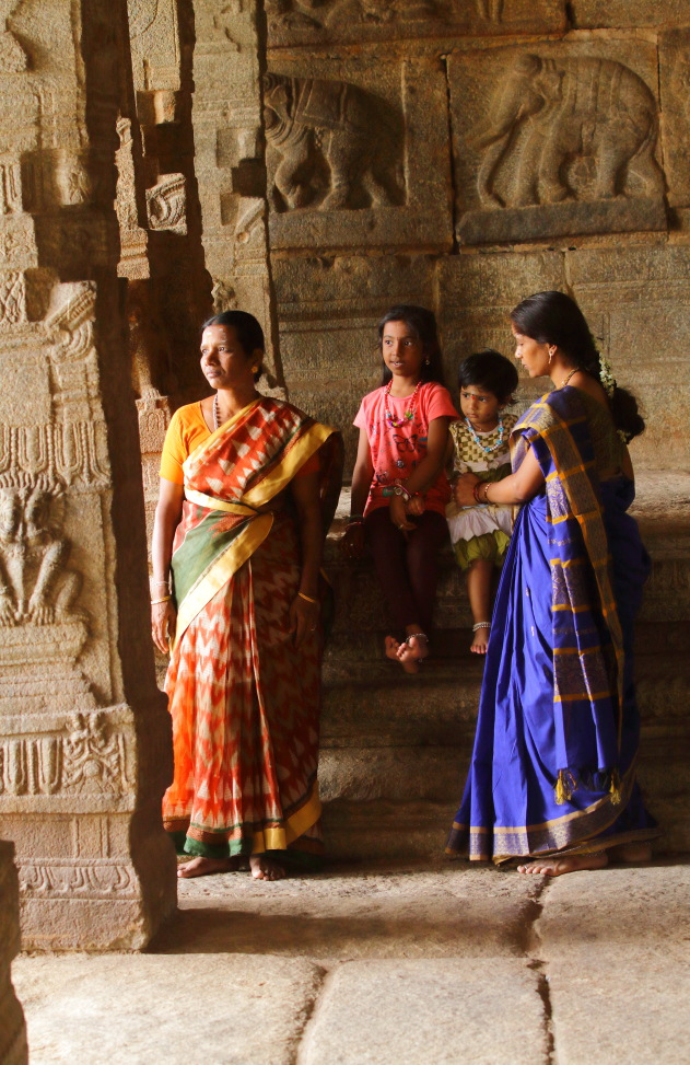 Colorful sarees liven up the monotones of Lepakshi Temple, Andhra Pradesh
