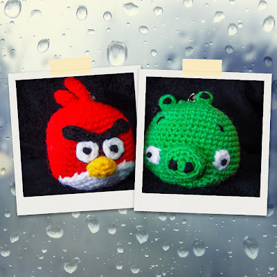 crocheted red angry bird and green pig amigurumi