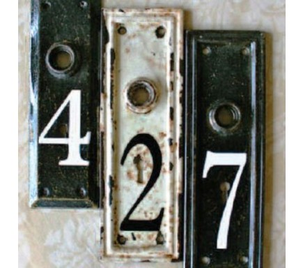 These vintage doorknob plates were upcycled into a cook address sign