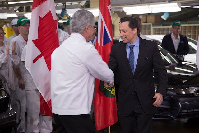 Minister Duguid shaking hands with Jerry Chenkin, President and CEO of H...