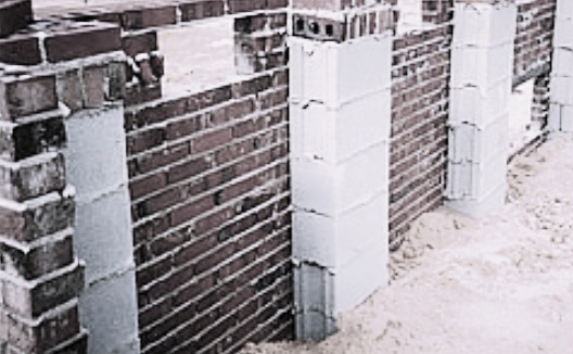 Hollow pier and curtain wall foundation