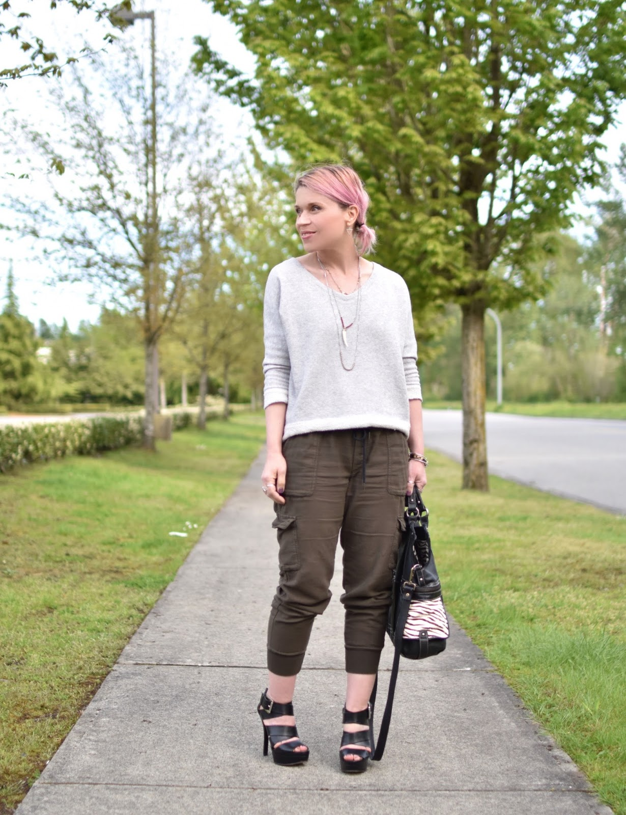 Monika Faulkner outfit inspiration - styling slouchy cargo pants with a sweatshirt and strappy platform sandals