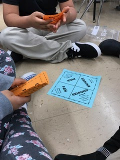 picture of students playing Fan and Pick, part of a lesson plan on Rumors and Gossip