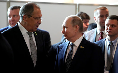 Vladimir Putin with Foreign Minister Sergei Lavrov before the start of the G20 summit.