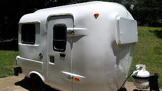Painted white, U-haul CT-13 fiberglass camper.