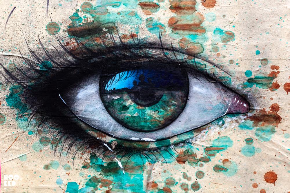 Street Artist My Dog Sighs paste-ups of a large eye jn London, UK