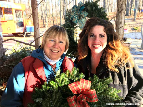 Christmas tree owner and me with a fresh made wreath from Walking on Sunshine.