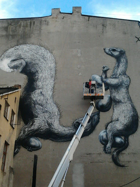 Street Artist ROA Working on a New Mural in Lodz, Poland for Fundacja Urban Forms. 9