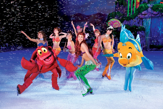 Ariel on ice with sisters