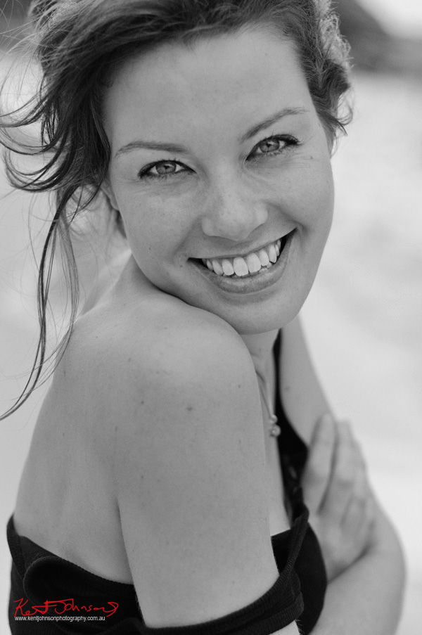 Bridget, huge smile, beach portrait in black and white for a modelling portfolio - Photographed by Kent Johnson, Sydney, Australia.