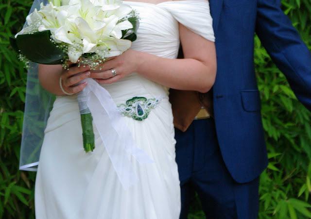 Aplikacja na suknię ślubną w kolorze zielonym.