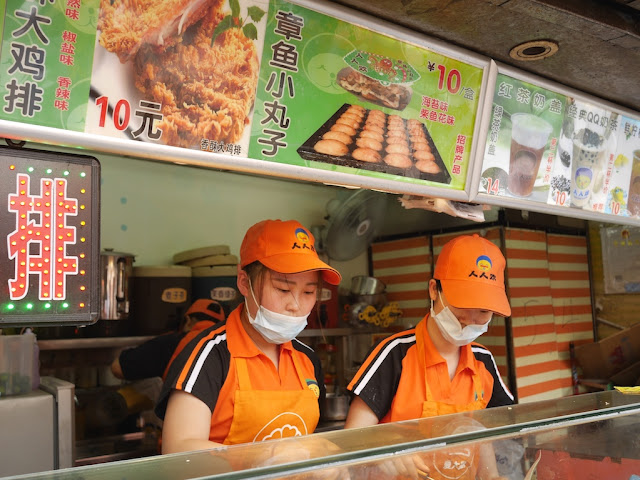 two young women preparing fish balls