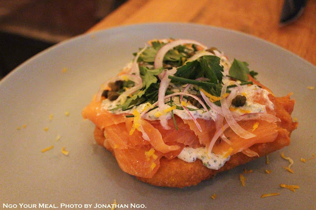 Hungarian Potato Fry Bread: Smoked Salmon, Kefir Ranch, Crispy Caper, Fresh Herbs at Covina