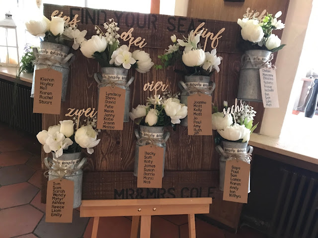 table seating plan wooden board with milk churns, Wedding abroad, Mountain wedding lake-side at the Riessersee Hotel Resort Bavaria, Germany, Garmisch-Partenkirchen