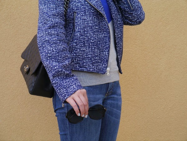 Textured moto jacket, oversize octagonal shades, Chanel 2.55, baby blue nails