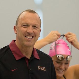 Head Coach Neil Harper and one of his Arkansas Razorbacks swimmers