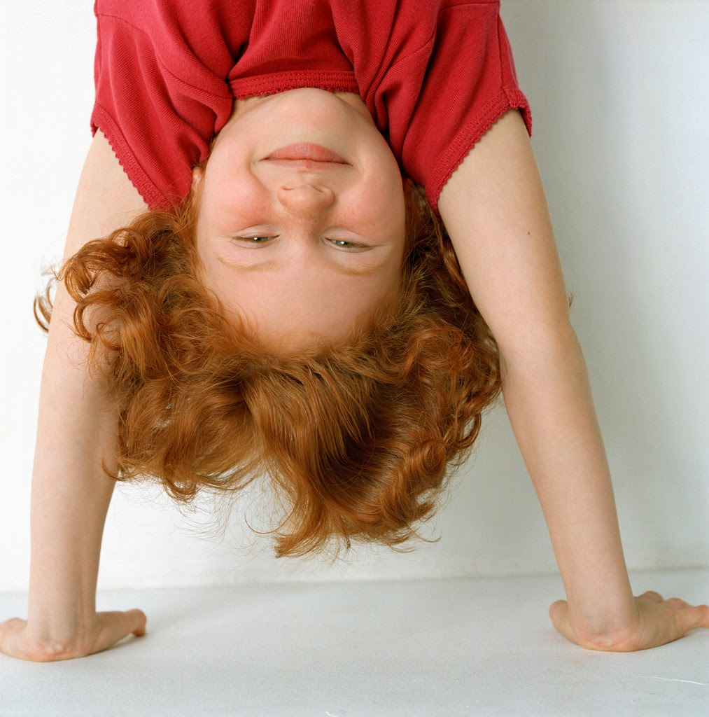 child doing handstand
