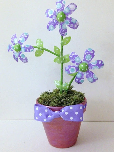 a cute tutorial for making flowers out of those water  bottles we throw away.