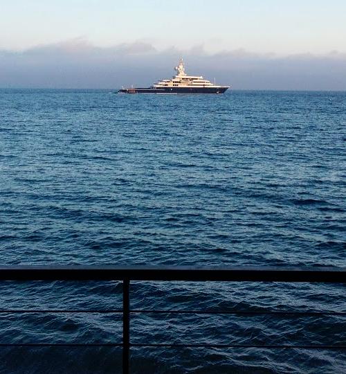 Large blue ship at sea
