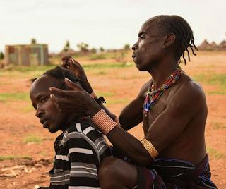 Braiding hair Hamar Tribe Ethiopia