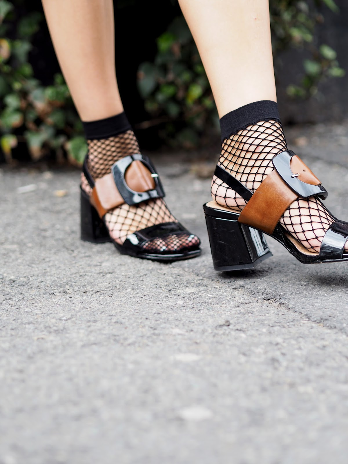 Next Buckle Sandals styled with Fish Net Socks