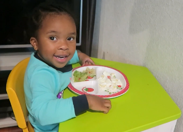 Toddler eating healthy foods