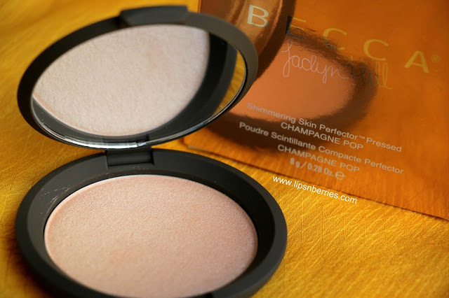 becca highlighter champagne pop review