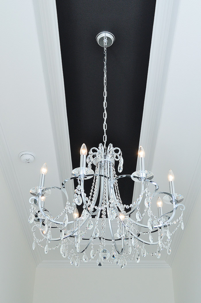 8-Light Chrome and Crystal Chandelier by Crystorama in a black and white foyer | via monicawantsit.com