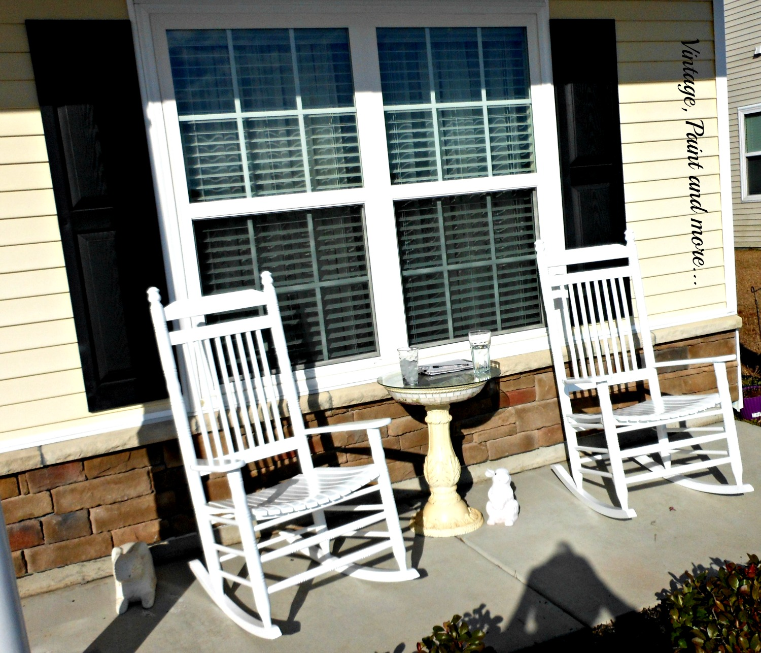 Southern porch with white wooden rockers