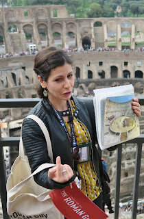 Rome tour guide with Colosseum in background.