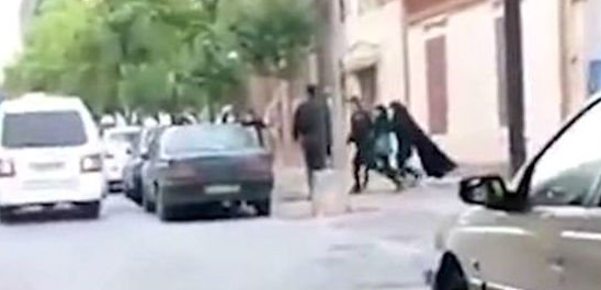 See Iran 'morality police' drag woman off street