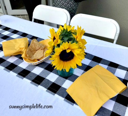 table centerpieces with sunflowers, check table runner