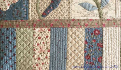 Scrappy quilted piano key border