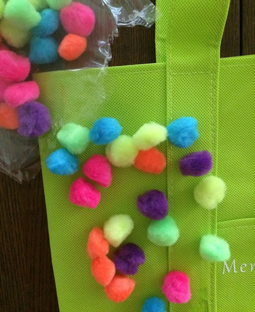 Want a cute tote bag for the pool or beach? Turn a plain Dollar store bag into a bright mermaid tote with pom poms using your Cricut!