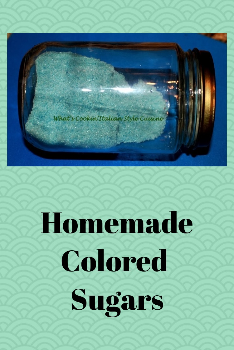 This is a jar filled with homemade colored sugar. This colored sugar is blue. The jar is a mason jar imported from Italy with a cover on top to keep the colored sugar fresh and not in clumps or hard.