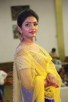 Actress Eesha in Yellow Choli Blue Ghagra at Darshakudu music launch 017.JPG