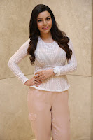 Kyra Dutt in Tight White Top Trousers at Paisa Vasool audio success meet ~  Exclusive Celebrities Galleries 009.JPG