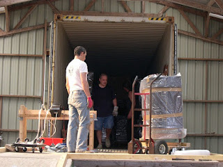 Loading a container of French Antiques by hand